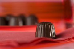 Still-life with detail of chocolate bonbons Royalty Free Stock Images