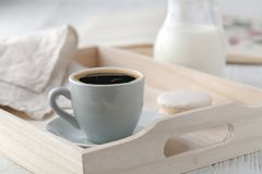 Still life details, cup of tea on retro vintage wooden tray on a coffee table in living room stock images