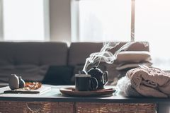 Tea with steam in room in morning sunlight Stock Photo