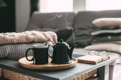 Tea with steam in room in morning sunlight Stock Images