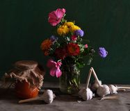 Still life with different flowers and jar of jam Stock Photos