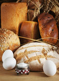 Still life with different rye bread. On a wooden table Royalty Free Stock Photos