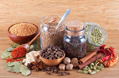 Still life of different spices on wood Stock Photography