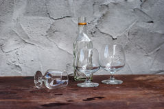 Still Life with differently shaped glass bottles. On wooden table Stock Photo
