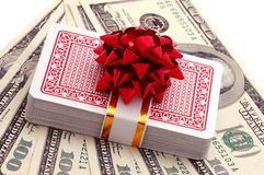Still-life of dollars and playing cards with bow Royalty Free Stock Photos