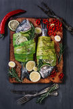 Still life with dorados wrapped in leek royalty free stock photo