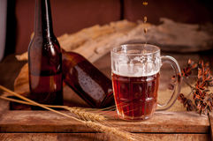 Still Life with a draft beer by the glass on wooden table Royalty Free Stock Image