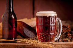 Still Life with a draft beer by the glass on wooden table Royalty Free Stock Photography