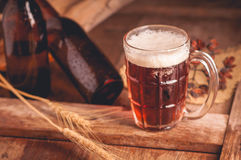 Still Life with a draft beer by the glass on wooden table Royalty Free Stock Photos