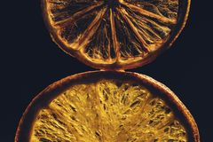 Still life with dried slices of orange, lemon on the  black background. Selective and soft focus royalty free stock photos