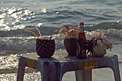 Still-life with drinks on the beach Stock Photo