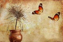 Still life with the dry in a cooper pot and colorful butterflies Royalty Free Stock Photography
