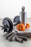 Still-life of dumbbells, hand grip with fashionable earphones Stock Photos