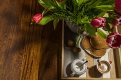 Still life of dutch tulips and syrup waffles on a serving tray w royalty free stock image