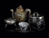 Still life in east style. With the Japanese teapot, a coffee cup and a sugar bowl Royalty Free Stock Images