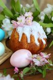 Painted eggs and easter cake on a wooden table. Still life with Easter cakes, painted eggs and flowers. Easter cake and eggs. Easter composition. Easter cake and royalty free stock photo