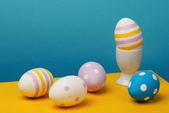 Still-life from Easter eggs on a multi-colored background. Festive subjects close-up Royalty Free Stock Image