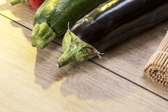 Still life with eggplant and zucchini Stock Photos