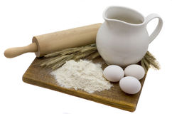 Still-life with eggs. Flour, wheaten ears, milk and eggs Royalty Free Stock Image