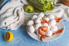 Still life with eggs. Apple, vegetables and decoration Royalty Free Stock Images