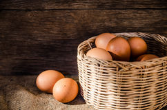 Still life eggs and basket composition Stock Photos