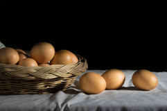 Still life eggs in basket. Stock Photos