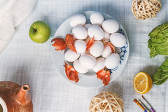 Still life with eggs and decoration. Still life with eggs, apple, brushes and decoration Royalty Free Stock Photo