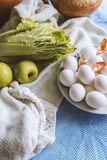 Still life with eggs and decoration. Still life with eggs, apple, vegetabels and decoration Stock Photography