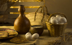 Still life eggs and milk in the basket Royalty Free Stock Photos