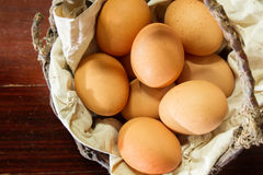 Still life eggs in old basket Stock Photography