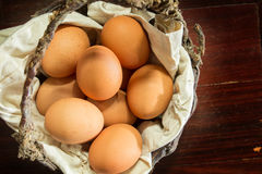 Still life eggs in old basket Stock Photo