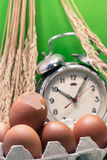 Still life with eggshells and eggs, old broken alarm clock, padd Royalty Free Stock Photography