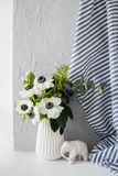 Still-life with an elegant bouquet of anemones Stock Photos