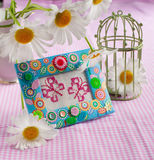 Still life with embroidered cross-stitch butterflies Stock Photography