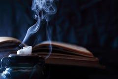 Extinguished Candle Near Book stock image