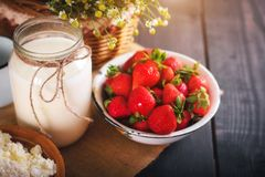 Still life of farm products. Milk and strawberry close-up. royalty free stock photo