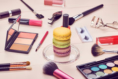 Still life of fashion woman, essentials cosmetics. Still life, fashion woman essentials cosmetics. Beauty makeup accessories. Macarons french dessert. Lipstick Stock Image