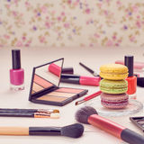 Still life of fashion woman, essentials cosmetics. Still life, fashion woman essentials cosmetics. Beauty makeup accessories. Macarons french dessert. Lipstick Royalty Free Stock Photo