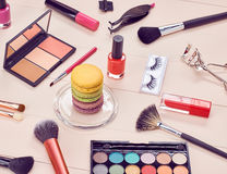 Still life of fashion woman, essentials cosmetics. Still life, fashion woman essentials cosmetics. Beauty makeup accessories. Macarons french dessert. Lipstick Stock Photo