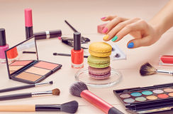 Still life of fashion woman, essentials cosmetics. Still life, fashion woman essentials cosmetics. Beauty makeup accessories. Macarons french dessert. Lipstick Stock Photos