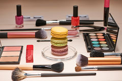 Still life of fashion woman, essentials cosmetics. Still life, fashion woman essentials cosmetics. Beauty makeup accessories. Macarons french dessert. Lipstick Stock Images