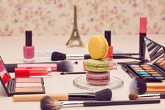 Still life of fashion woman, essentials cosmetics. Still life, fashion woman essentials cosmetics. Beauty makeup accessories. Macarons french dessert. Lipstick Royalty Free Stock Photos