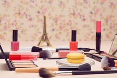 Still life of fashion woman, essentials cosmetics. Still life, fashion woman essentials cosmetics. Beauty makeup accessories. Macarons french dessert. Lipstick Royalty Free Stock Images