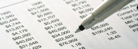 Still-life of Financial Statement. (focus on the tip of pen Stock Image