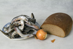 Still life with fish, bread and vegetables Royalty Free Stock Photography