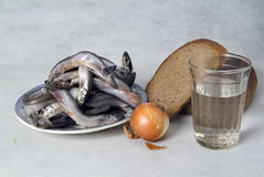 Still life with fish, bread and vegetables Stock Photos