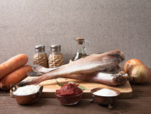 Still life with fish, vegetables and spices on a wooden board Royalty Free Stock Image