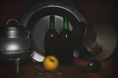 Flamenco style still life, metal objects, bottles and apple. Still life flamenco style of the Baroque period and mannerism, with shiny metallic objects, bottles Royalty Free Stock Images