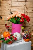 Still life with flower arrangements in pumpkins and hydrangea in a box stock photo