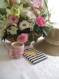 Still life with flower bouqet. Lady hat, planner and flower bouqet stock images